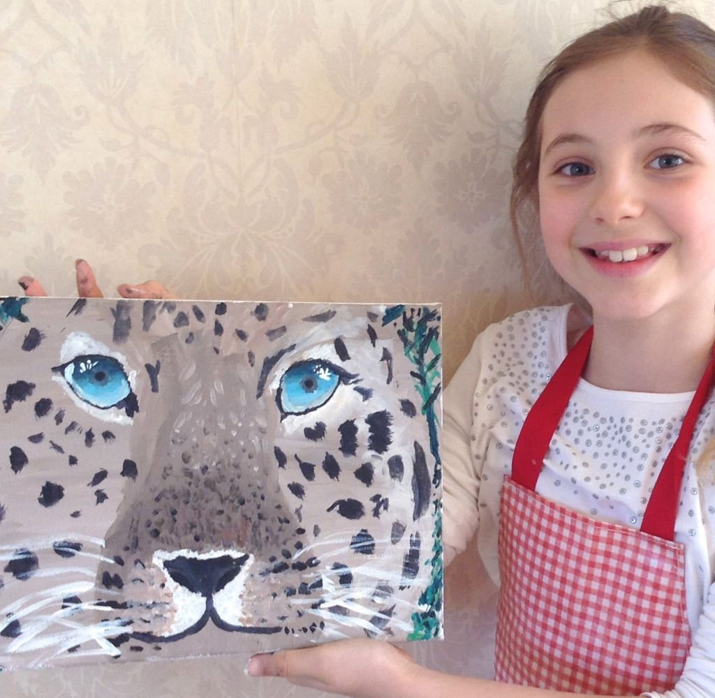 Young girl with finished painting