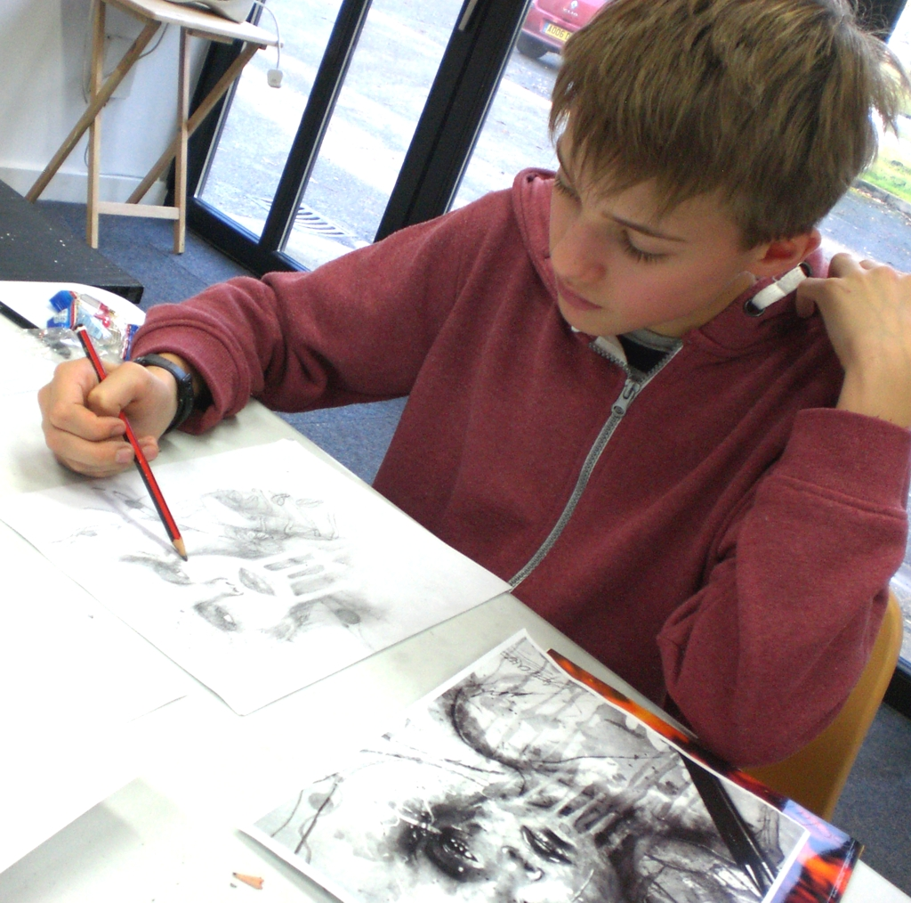Young boy in drawing class