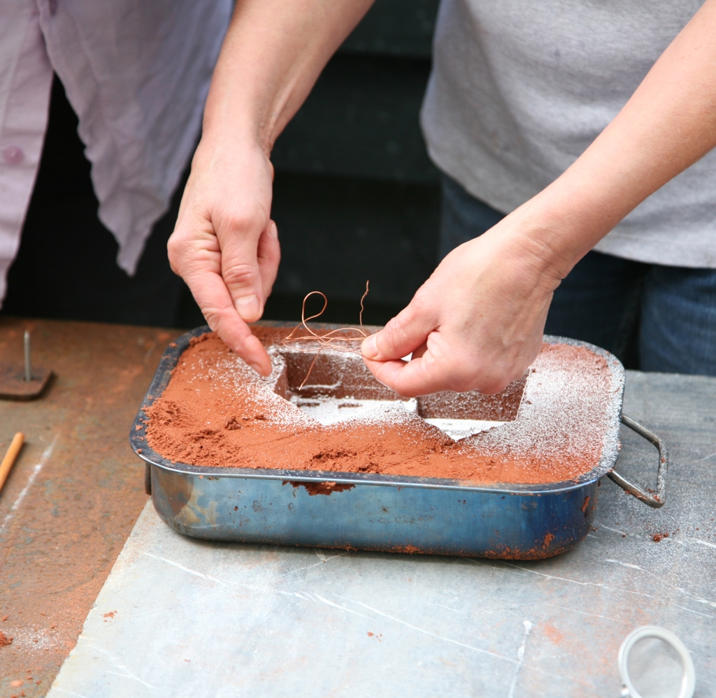 Creating the sand mould in glass sand casting lessons